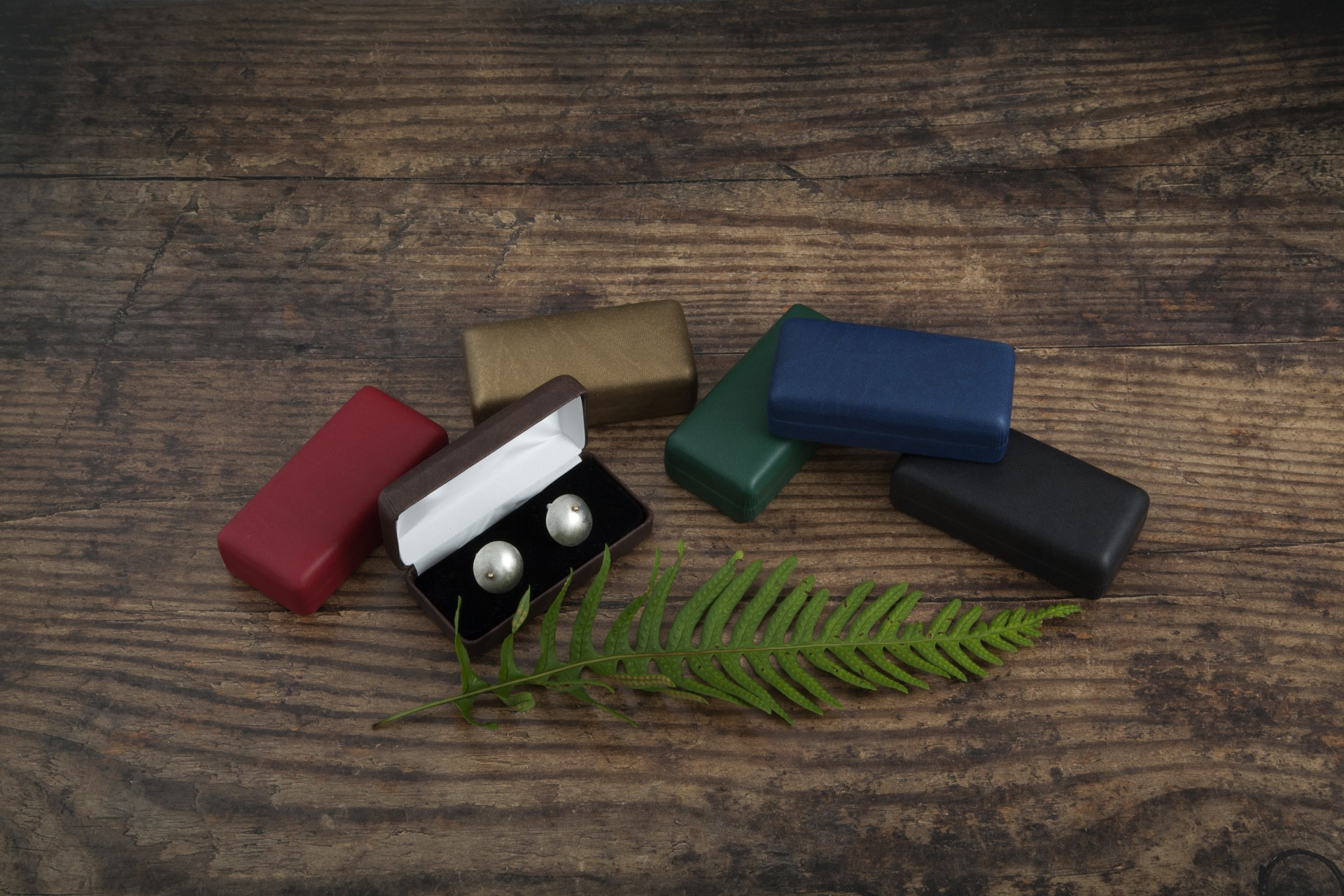 Cufflink boxes with wood background